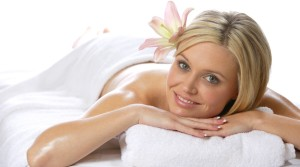 A woman relaxes after getting a massage at a day spa
